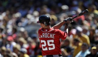 Washington Nationals' Adam LaRoche (25)warms up in the on deck circle during a baseball game against the Pittsburgh Pirates in Pittsburgh Sunday, May 5, 2013. The Nationals won 6-2. (AP Photo/Gene J. Puskar)