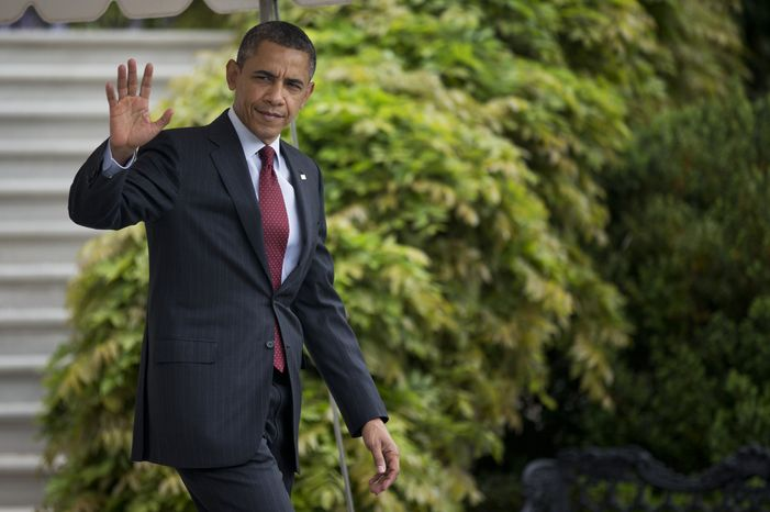 President Obama waves as he leaves the White House in Washington on his way to Columbus, Ohio, on Sunday, May 5, 2013. (AP Photo/Manuel Balce Ceneta)