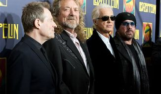 """Led Zeppelin — from left, John Paul Jones, Robert Plant, Jimmy Page and Jason Bonham (son of original drummer, the late John Bonham) at the""""'Led Zeppelin: Celebration Day"""" premiere in New York last year. According to a report, former President Clinton asked the band to reunite last year for the Superstorm Sandy benefit concert, but they turned him down. (Photo by Dario Cantatore/Invision/AP, file)"""