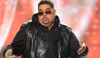 In this 2011 photo, rapper Heavy D, also known as Dwight Arrington Myers, performs during the BET Hip Hop Awards in Atlanta. In recent years a series of notable rappers have died of drug- and health-related causes. Since 2011, hip-pop pioneer Heavy D, singer and rap chorus specialist Nate Dogg and New York rapper Tim Dog all died of ailments in their 40s. (AP Photo/David Goldman, file)