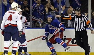 Washington Capitals defenseman John Erskine (4) watches as New York Rangers center Derek Stepan (21) reacts after scoring the winning goal in their 4-3 victory during the third period of Game 3 of their first-round NHL hockey Stanley Cup playoff series in New York, Monday, May 6, 2013. (AP Photo/Kathy Willens)