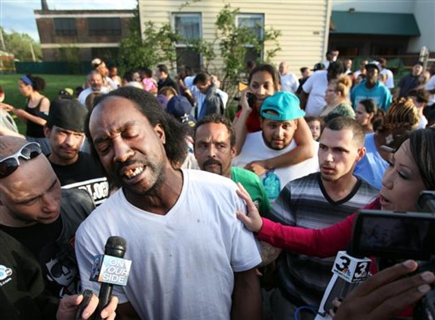 ** FILE ** Neighbor Charles Ramsey speaks to media near the home on the 2200 block of Seymour Avenue, where three missing women were rescued in Cleveland, on Monday, May 6, 2013. (AP Photo/The Plain Dealer, Scott Shaw)