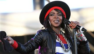 Singer Lauryn Hill, pictured at the Coachella music festival in Indio, Calif. in 2011, was sentenced Monday to three months in prison for not paying federal taxes on $1.8 million earned from 2005 to 2007. (AP Photo/Spencer Weiner, file)