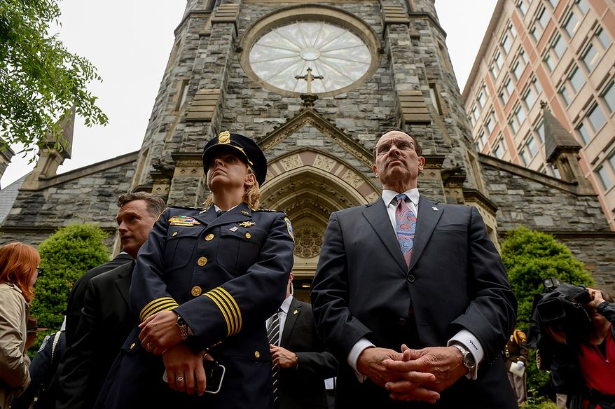 Washington, D.C. Mayor Vincent Gray, right, and Washington, D.C. Metropolitan Police Chief Cathy Lanier, second from right, listen to bagpipers from an assortment of local police jurisdictions as they play outside St. Patrick Catholic Church at the conclusion of Blue Mass, Washington, D.C., Tuesday, May 7, 2013. The Blue Mass is held to pray for those in law enforcement and fire safety, remember those who have fallen, and support those who serve at the beginning of National Police Week.  (Andrew Harnik/The Washington Times)
