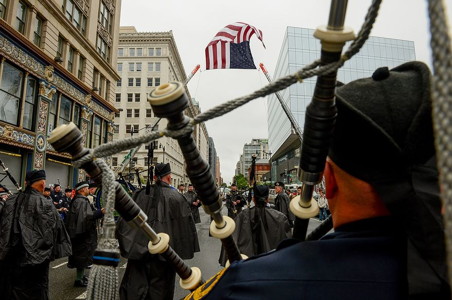 Bagpipers from an assortment of local police jurisdictions play outside St. Patrick Catholic Church at the conclusion of Blue Mass, Washington, D.C., Tuesday, May 7, 2013. The Blue Mass is held to pray for those in law enforcement and fire safety, remember those who have fallen, and support those who serve at the beginning of National Police Week.  (Andrew Harnik/The Washington Times)