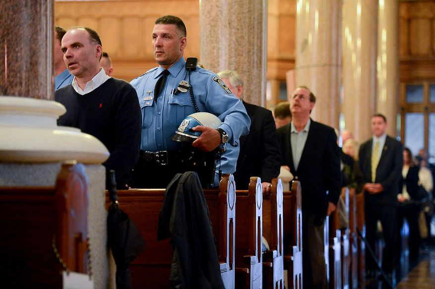 Law enforcement and public safety officials stand during Blue Mass at St. Patrick Catholic Church, Washington, D.C., Tuesday, May 7, 2013. The Blue Mass is held to pray for those in law enforcement and fire safety, remember those who have fallen, and support those who serve at the beginning of National Police Week.  (Andrew Harnik/The Washington Times)