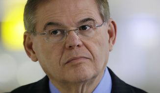 ** FILE ** In this March 1, 2013, file photo Sen. Robert Menendez, D-N.J., participates in a news conference at an airport in Newark, N.J. (AP Photo/Mel Evans, File)