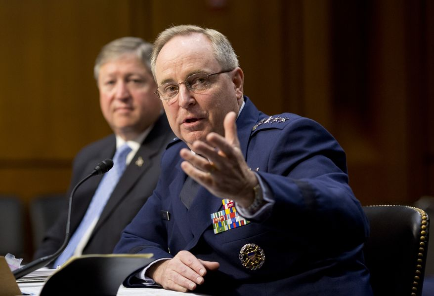 Gen. Mark A. Welsh III (right), the Air Force chief of staff, and Secretary of the Air Force Michael B. Donley (left) appear before the Senate Armed Services Committee on Capitol Hill in Washington on Tuesday, May 7, 2013. Besides funding for next year's Pentagon budget, the Air Force is dealing with controversy over sexual assaults and how the military justice system handles it. (AP Photo/J. Scott Applewhite)