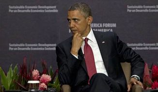 President Obama listens to a question as he attends an economic forum in San Jose, Costa Rica, Saturday, May 4, 2013. (AP Photo/Moises Castillo)