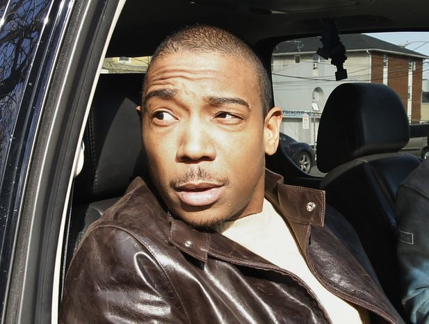 ** FILE ** The rapper Ja Rule is pictured in a vehicle outside the Martin Luther King Jr. Federal Building and Courthouse in Newark, N.J., after pleading guilty to federal tax evasion charges on March 22, 2011. (AP Photo/Julio Cortez)
