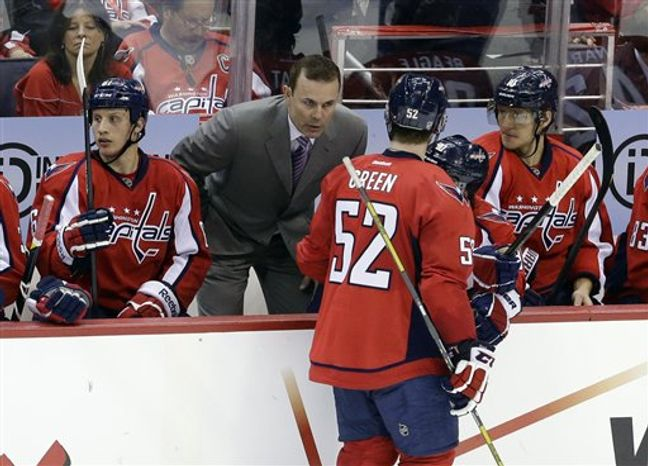 Adam Oates gave his Capitals players the day off Tuesday in New York City. (Associated Press)