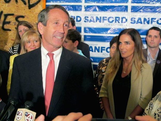 ** FILE ** Mark Sanford is headed back to Washington for this second turn in the House of Representatives, this time with fiancee Maria Belen Chapur at his side. (Associated Press)