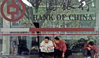 One of China's biggest banks on Tuesday said it has halted business with the Foreign Trade Bank of North Korea, accused by the U.S. of financing Pyongyang's missile and nuclear programs, in a recent sign of Beijing pressuring its ally. (Associated Press)