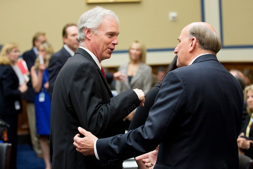 Sen. Ron Johnson (R-Wis.), left, the senator who former Secretary of State Hillary Clinton yelled at during a senate hearing on the attacks in Benghazi, speaks with Rep. Louie Gohmert (R-Texas), right, before a House Oversight and Government Reform Committee hearing on the September 11, 2012 attack in Benghazi, Libya on Capitol Hill, Washington, D.C., Wednesday, May 8, 2013. (Andrew Geraci/The Washington Times)