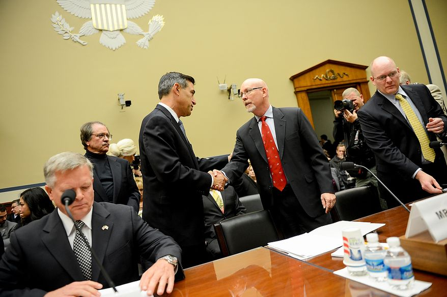 Chairman Darrell Issa (R-Calif.), second from left, greets Foreign Service Officer and former Deputy Chief of Mission/ChargÈ díAffairs in Libya Gregory Hicks before he  testifies before a House Oversight and Government Reform Committee hearing on the September 11, 2012 attack in Benghazi, Libya on Capitol Hill, Washington, D.C., Wednesday, May 8, 2013. Also pictured is State Department officials Acting Deputy Assistant Secretary for Counterterrorism Mark Thompson, left, and Diplomatic Security Officer and former Regional Security Officer in Libya Eric Nordstrom, right. (Andrew Harnik/The Washington Times)
