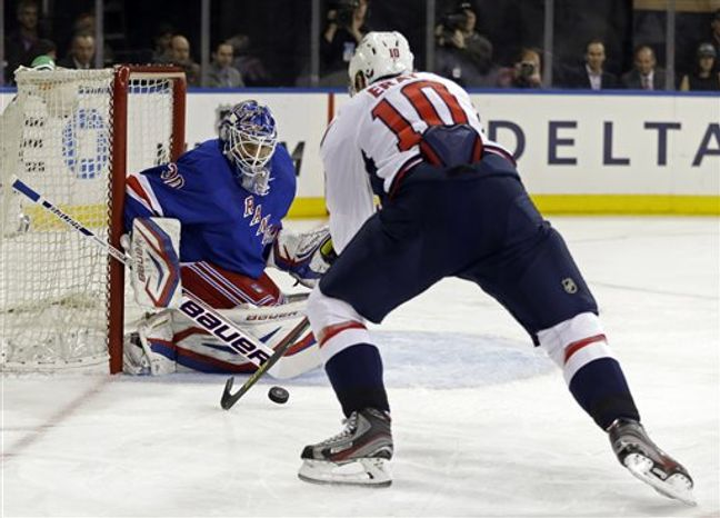 Washington Capitals left wing Martin Erat (10), of the Czech Republic, takes a shot on New York Rangers goalie Henrik Lundqvist (30), of Sweden, in the first period of Game 4 of their first-round NHL hockey Stanley Cup playoff series in New York, Wednesday, May 8, 2013. (AP Photo/Kathy Willens)