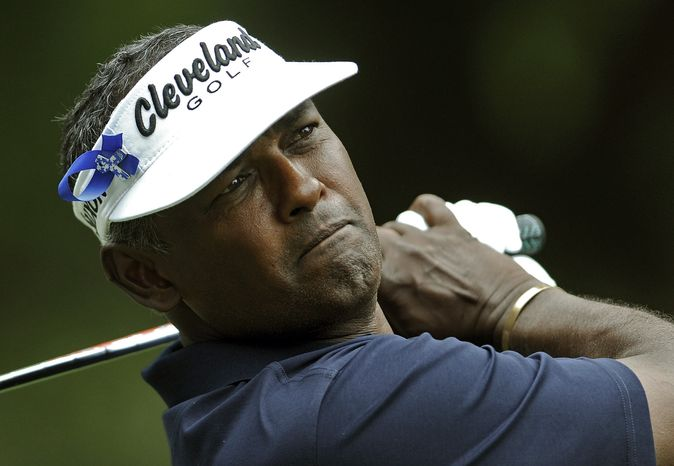 """FILE - In this April 19, 2013, file photo, Vijay Singh, of Fiji, tees off on the ninth hole while wearing an """"Els for Autism"""" ribbon in his visor during the second round of the RBC Heritage golf tournament in Hilton Head Island, S.C. Singh no longer faces any sanction for using deer antler spray. The PGA Tour said Tuesday, April 30, 2013, that it was dropping the case against the three-time major champion. Tour commissioner Tim Finchem says new information from the World Anti-Doping Agency indicates that using deer antler spray is no longer considered prohibited. (AP Photo/Stephen Morton, File)"""