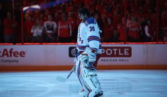 New York Rangers goalie Henrik Lundqvist (30) stands for the national anthem before the start of Game 2 of a Stanley Cup NHL playoff hockey series against the Washington Capitals on Saturday, May 4, 2013, in Washington. (AP Photo/Evan Vucci)