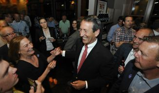 Former South Carolina Gov. Mark Sanford is greeted by supporters as he arrives to give his victory speech on Tuesday, May 7, 2013, in Mount Pleasant, S.C. Sanford won back his old congressional seat in the state's 1st District in a special election. (AP Photo/Rainier Ehrhardt)