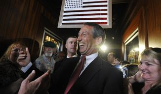 Former South Carolina Gov. Mark Sanford is greeted by supporters as he arrives to give his victory speech on Tuesday, May 7, 2013, in Mt. Pleasant, S.C. Sanford won back his old congressional seat in the state's 1st District in a special election. (AP Photo/Rainier Ehrhardt)