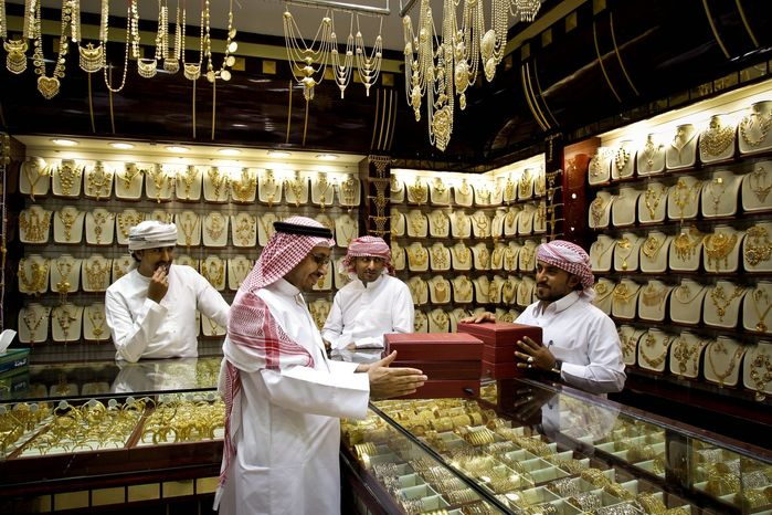 Analysts debate whether gold prices could rebound toward the record high of nearly $1,900 an ounce, as central governments and investors look to the commodity as a safe bet in an unsteady world economy. (Associated Press)