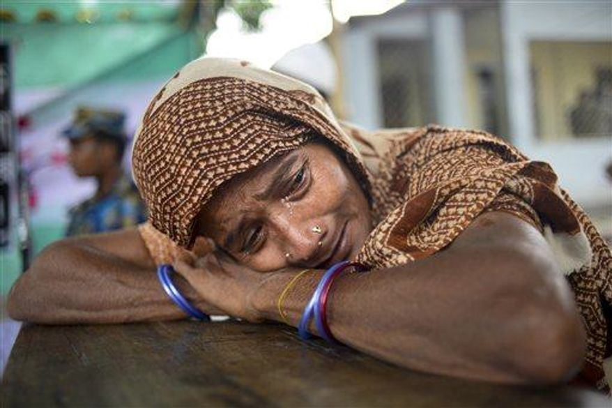 A Bangladeshi woman cries after failed attempts on finding her missing daughter at a makeshift morgue in Savar, near Dhaka, Thursday, May 9, 2013, after the collapse of a garment factory building. (AP Photo/Ismail Ferdous)