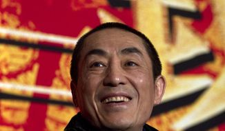 ** FILE **  In this Dec. 22, 2010, file photo, Chinese director Zhang Yimou smiles during a press conference to promote his new movie in Beijing. Media reports circulated online this week that Zhang Yimou, who is also known as the architect of the opening ceremony for the Beijing Olympics, has seven children from his two marriages and from relationships with two other women. (AP Photo/Alexander F. Yuan, File)
