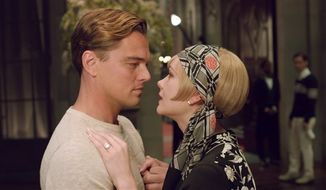 "Leonardo DiCaprio as Jay Gatsby and Carey Mulligan as Daisy Buchanan are pictured in a scene from ""The Great Gatsby."" (AP Photo/Warner Bros. Pictures)"