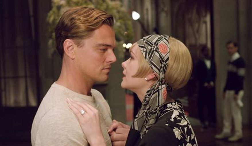 """Leonardo DiCaprio as Jay Gatsby and Carey Mulligan as Daisy Buchanan are pictured in a scene from """"The Great Gatsby."""" (AP Photo/Warner Bros. Pictures)"""