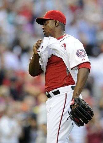 Washington Nationals relief pitcher Rafael Soriano (29) untucks his jersey as the Nationals defeat the Detroit Tigers 5-4 in a baseball game, Thursday, May 9, 2013, in Washington. (AP Photo/Nick Wass)