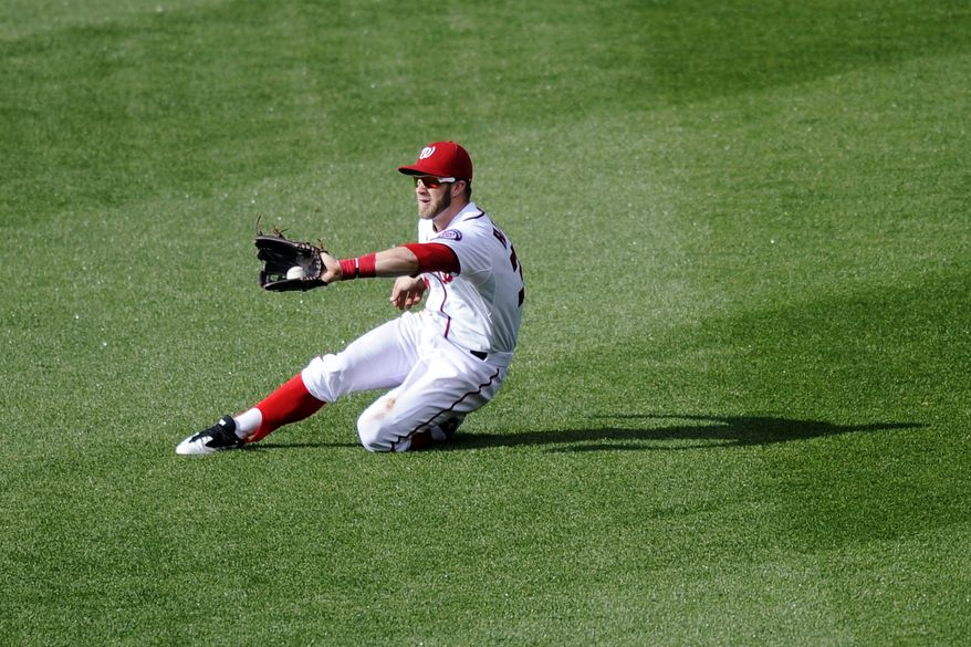 Washington Nationals right fielder Bryce Harper (34) catches a liner by Detroit Tigers' Alex Avila during the fourth inning of a baseball game, Thursday, May 9, 2013, in Washington. (AP Photo/Nick Wass)