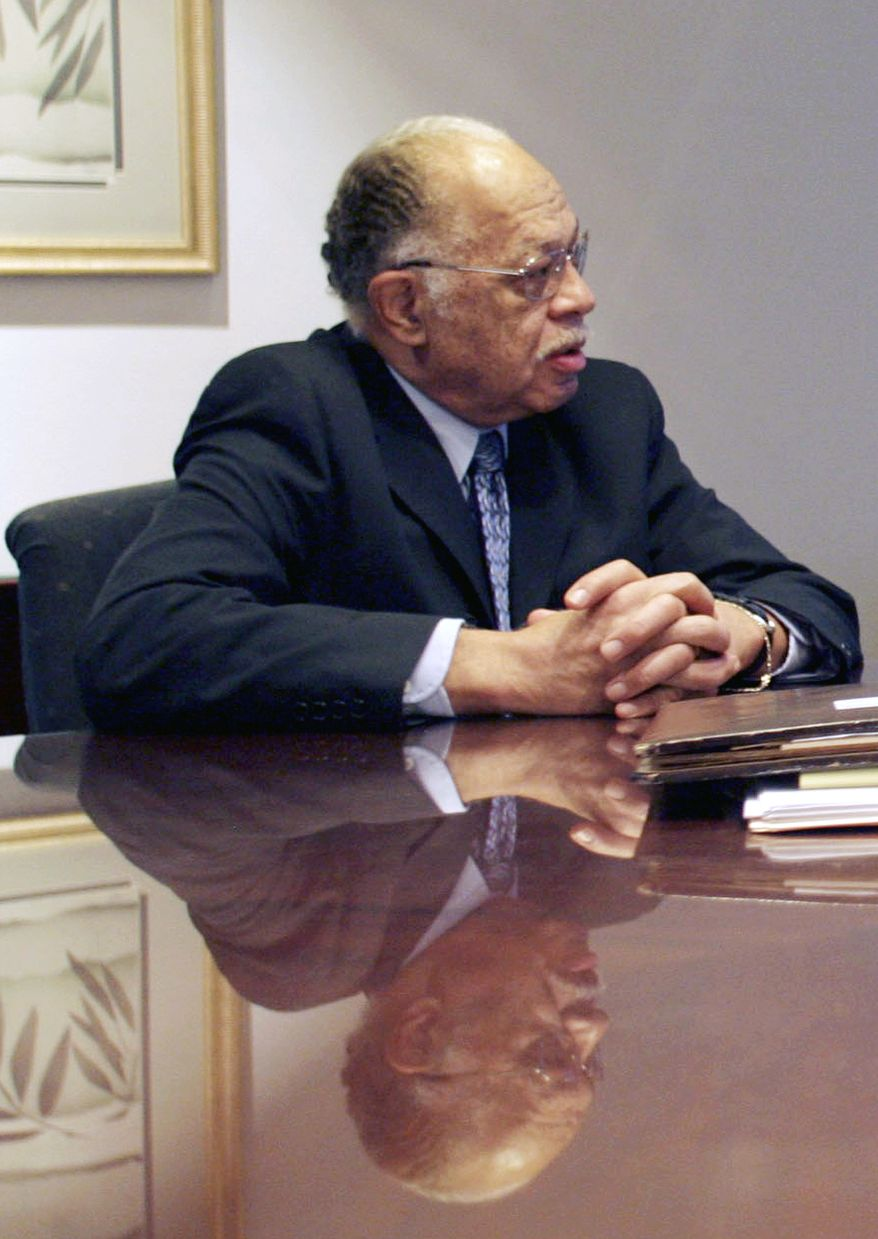 **FILE** Dr. Kermit Gosnell speaks to his attorney in Philadelphia on March 8, 2010. Gosnell, an abortion doctor who catered poor women at the Women's Medical Society, is charged with eight counts of murder in the deaths of a patient and seven babies who were born alive. (Associated Press)/Philadelphia Daily News, Yong Kim)