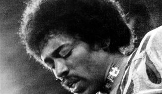 In this 1970 file photo, Jimi Hendrix performs on the Isle of Wight in England. (AP Photo/File)