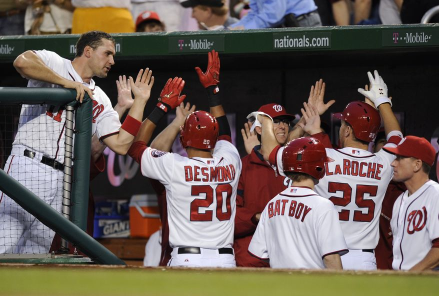 The Nationals celebrate after Ian Desmond hit his fifth home run of the season in the team's 7-3 victory over the Cubs. (Associated Press photo).