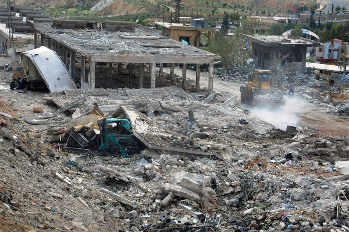 ** FILE ** Workers clear the rubble of buildings destroyed by an Israeli airstrike in Damascus, Syria, on May 5, 2013. The attack targeted a shipment of highly accurate, Iranian-made guided missiles believed to be on their way to Lebanon's Hezbollah militant group, officials and activists said. (Associated Press/SANA)