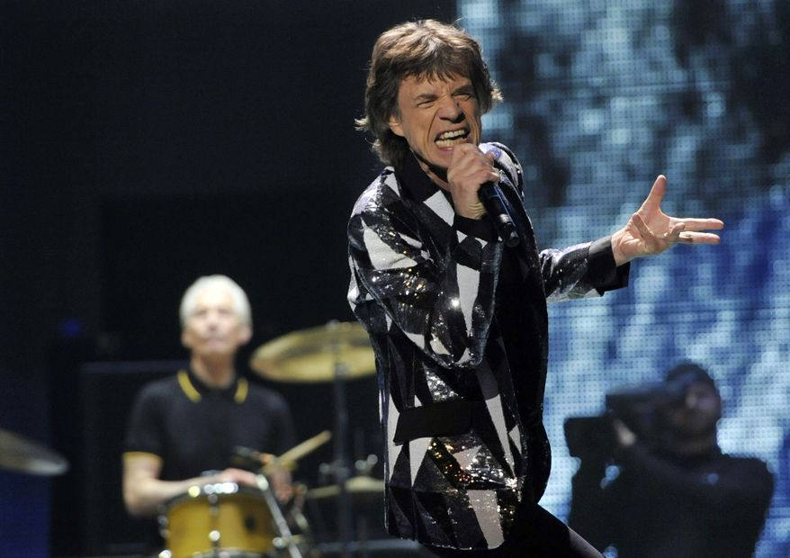 "**FILE** Mick Jagger of the Rolling Stones performs on the kickoff of the band's ""50 and Counting"" tour at the Staples Center in Los Angeles on May 3, 2013. (Chris Pizzello/Invision/Associated Press)"
