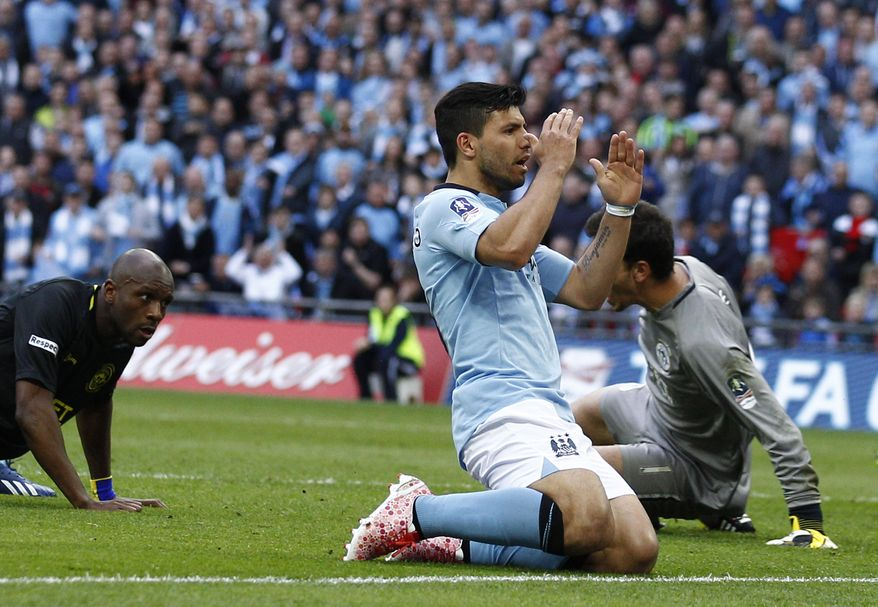 Manchester City's Sergio Aguero, center, reacts to his missed chance to score against Wigan Athletic during their English FA Cup final soccer match at Wembley Stadium, London, Saturday, May 11, 2013. (AP Photo/Jon Super)