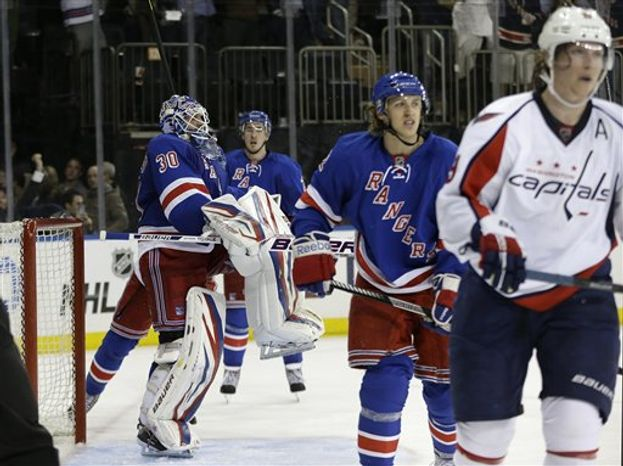 New York Rangers goalie Henrik Lundqvist (30) of Sweden and New York Rangers left wing Carl Hagelin, second from right, of Sweden reacts at the end of the third period of Game 4 of their first-round NHL Stanley Cup playoff series in New York, Wednesday, May 8, 2013. The Rangers evened the series by defeating the Capitals 4-3. (AP Photo/Kathy Willens)