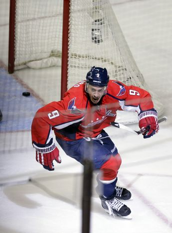 The Washington Capitals center Mike Ribeiro celebrates his game-winning goal in overtime of Game 5 first-round NHL Stanley Cup playoff hockey series against the New York Rangers, Friday, May 10, 2013, in Washington. The Capitals won 2-1, in overtime. (AP Photo/Alex Brandon)