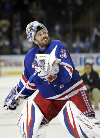 New York Rangers goalie Henrik Lundqvist (30), of Sweden, launches his stick into the stands after defeating the Washington Capitals in Game 6 of their NHL Stanley Cup hockey playoff series in New York, Sunday, May 12, 2013. The Rangers evened the series at 3-3 with a 1-0 shutout, forcing a Game 7 in Washington, Monday. (AP Photo/Kathy Willens)
