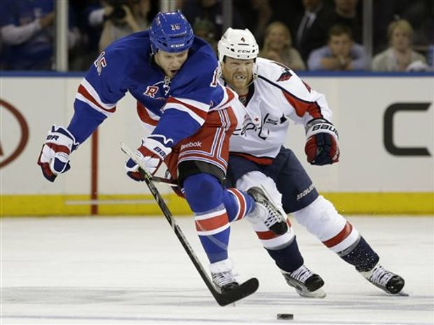 New York Rangers right wing Derek Dorsett (15) skates with Washington Capitals defenseman John Erskine (4) in pursuit in the second period of Game 6 of their NHL Stanley Cup hockey playoff series in New York, Sunday, May 12, 2013. The Rangers shut out the Capitals 1-0. (AP Photo/Kathy Willens)