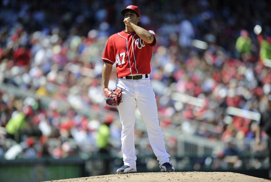 Washington Nationals starting pitcher Gio Gonzalez reacts after he gave up a hit to Chicago Cubs' Dioner Navarro (30) during the sixth inning of a baseball game, Sunday, May 12, 2013, in Washington. The Cubs won 2-1. (AP Photo/Nick Wass)