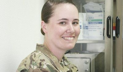 "Air Force Sgt. Sonja Parks, 30, the mother of two girls, says Mother's Day in Afghanistan will be ""just another day in a war zone."" But on Sunday, Sgt. Parks, a medic, will Skype will her girls and husband, whom she misses terribly. (Kristina Wong/The Washington Times)"