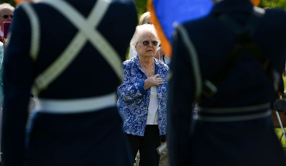 Jeanette Lilly, the mother of MIA 1st Lt. Lawrence Lilly stands for the Pledge of Allegiance at a Mother's Day ceremony to honor four American servicemen who have been added to the wall of the Vietnam Veterans Memorial, Washington, D.C., Sunday, May 12, 2013. (Andrew Harnik/The Washington Times)