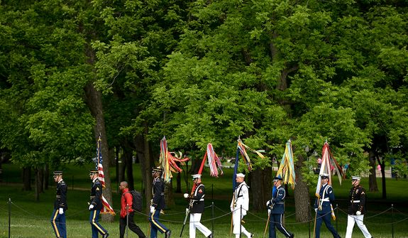 Members of the Joint Armed Forces Color Guard arrive to perform the presentation of the colors at a Mother's Day ceremony to honor four American servicemen who have been added to the wall of the Vietnam Veterans Memorial, Washington, D.C., Sunday, May 12, 2013. (Andrew Harnik/The Washington Times)