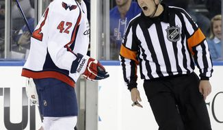 Washington Capitals right wing Joel Ward (42) yells referee Brad Watson (23) after he received a cross-checking penalty in the third period of Game 6 of the Capitals 1-0 loss to the New York Rangers in their NHL Stanley Cup hockey playoff series in New York, Sunday, May 12, 2013. The Rangers evened the series at 3-3 with a 1-0 shutout, forcing a Game 7 in Washington Monday. (AP Photo/Kathy Willens)