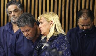 ** FILE ** Defense attorney Kathleen DeMetz, second from right, talks with Pedro Castro as Onil Castro, left, watches and Ariel Castro, right, looks down, in Cleveland Municipal court Thursday, May 9, 2013, in Cleveland. Ariel Castro was charged with four counts of kidnapping and three counts of rape. Pedro Castro pleaded no contest to an unrelated open-container charge in court Monday. Two unrelated misdemeanor charges against Onil Castro were dropped. Police announced on Thursday afternoon that 54-year-old Pedro Castro and 50-year-old Onil Castro had been released from jail. (AP Photo/Tony Dejak)