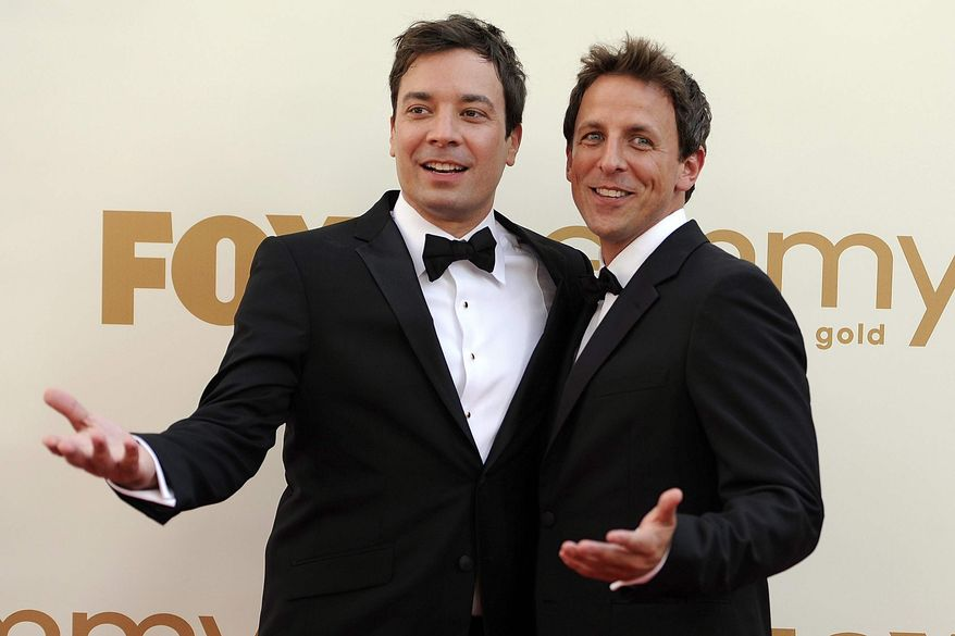"""** FILE ** This Sept. 18, 2011, file photo shows Jimmy Fallon, left, and Seth Meyers at the 63rd Primetime Emmy Awards in Los Angeles. Meyers is moving from his """"Weekend Update"""" desk to his own late night show on NBC. (AP Photo/Chris Pizzello, file)"""