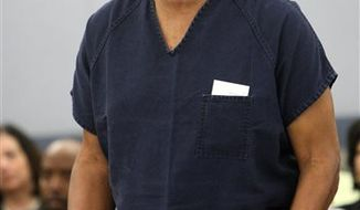 In this Dec. 5, 2008 photo, O.J. Simpson speaks during his sentencing at the Clark County Regional Justice Center courtroom in Las Vegas. On Monday Simpson returns to the courthouse where he was convicted of leading five men in an armed sports memorabilia heist to ask a judge for a new trial because, he says, his lawyer botched his defense. (AP Photo/Isaac Brekken, Pool, File)