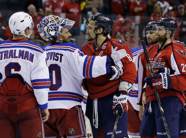 New York Rangers goalie Henrik Lundqvist (30), from Sweden, greets Washington Capitals left wing Alex Ovechkin (8), from Russia, after Game 7 first-round NHL Stanley Cup playoff hockey series, Monday, May 13, 2013 in Washington. The Rangers won 5-0. (AP Photo/Alex Brandon)